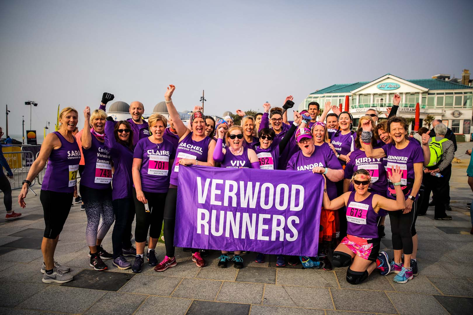 Verwood runners group photo in their purple gear with banner